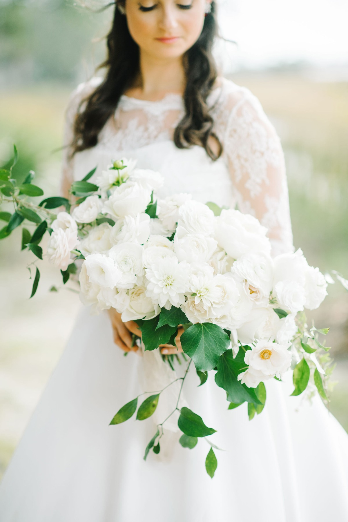 all white wedding bouquet with a small amount of greenery designed by Petaloso