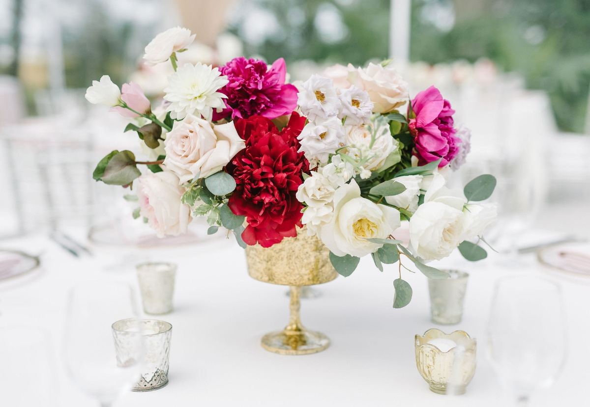 blush and white wedding centerpiece in a gold vessel designed by Petaloso