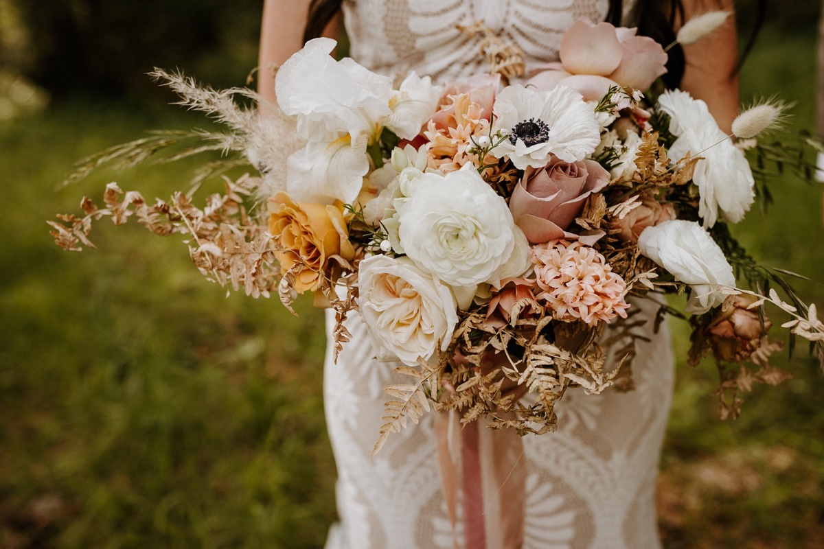 blush, white and yellow wedding bouquet designed by Freckled Fleurs