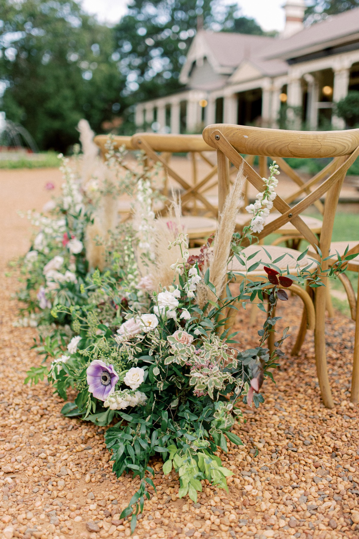 outdoor wedding ceremony with floral aisle decor