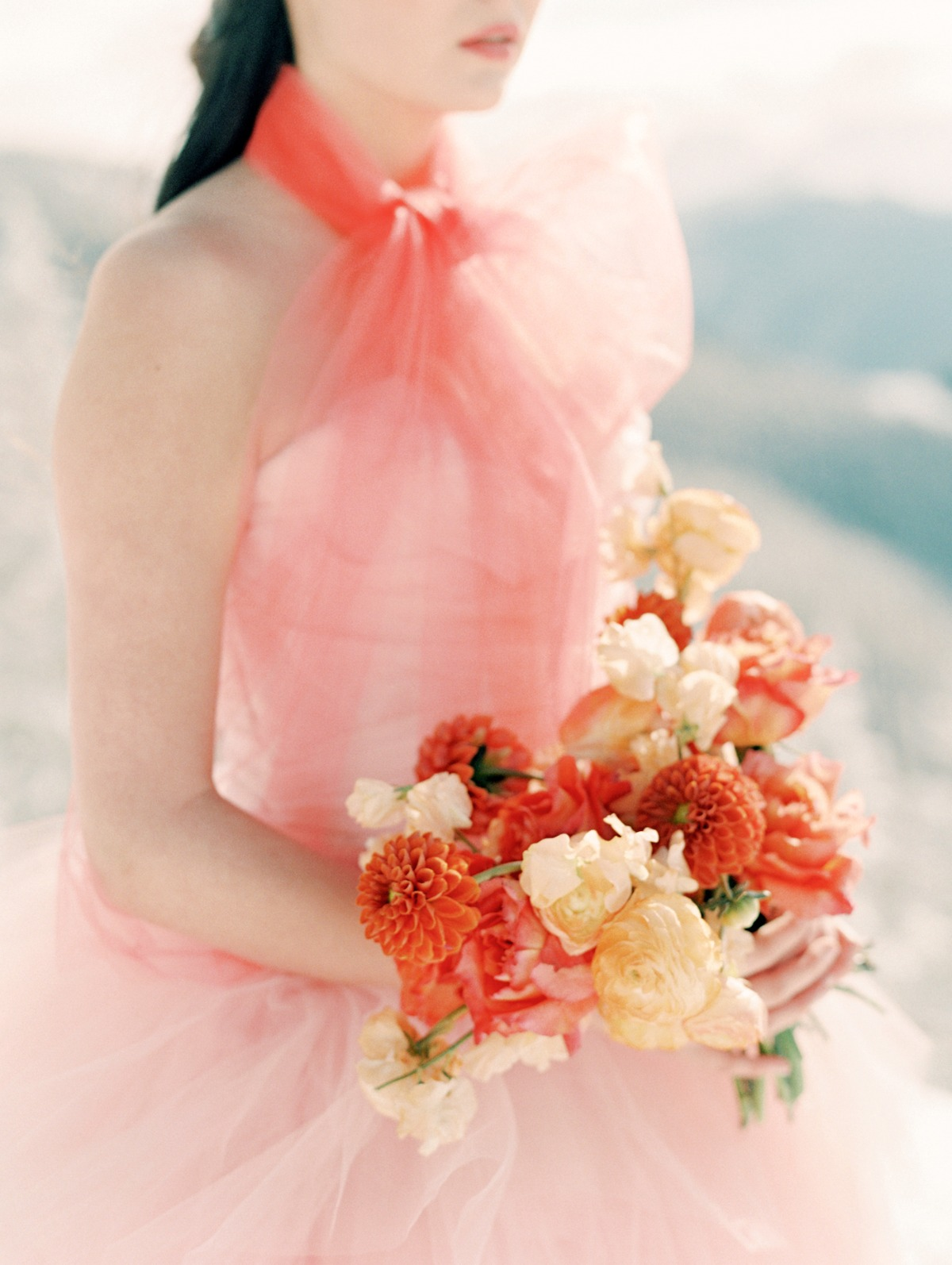 State and Arrow wedding bouquet in peach wedding gown