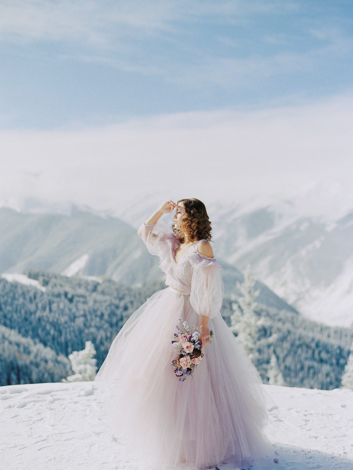 pastel colored Claire LaFaye wedding gown