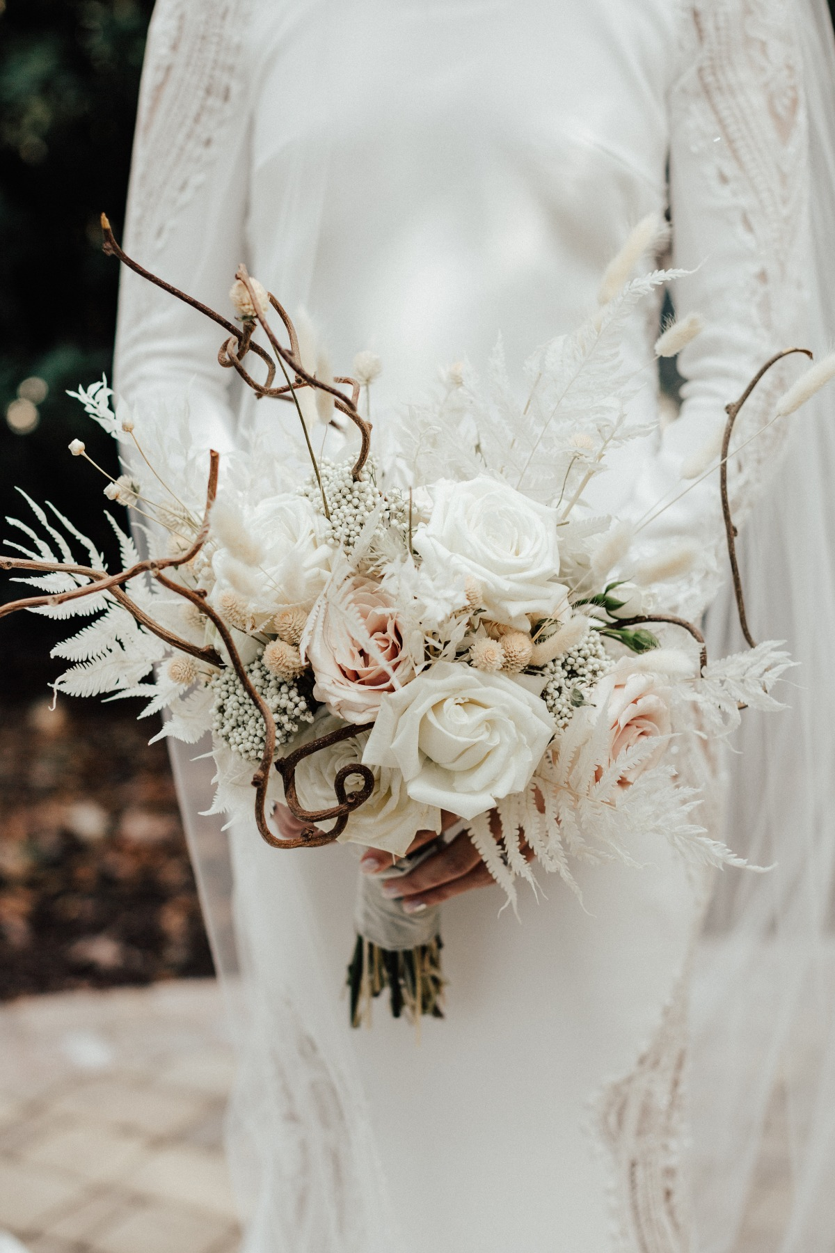 white wedding bouquet with fried florals and sticks