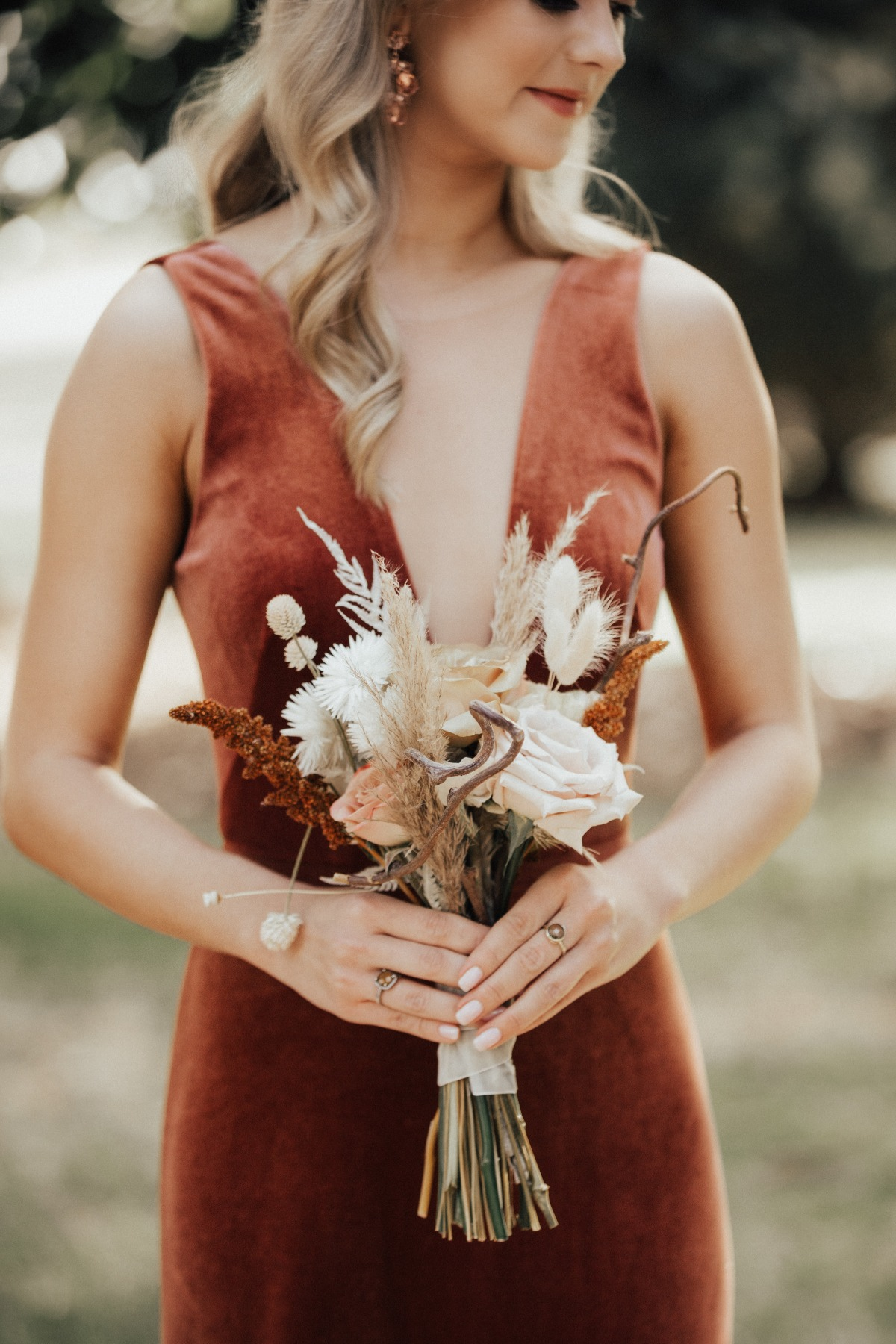 terra cotta bridesmaid dress with dried floral wedding bouquet