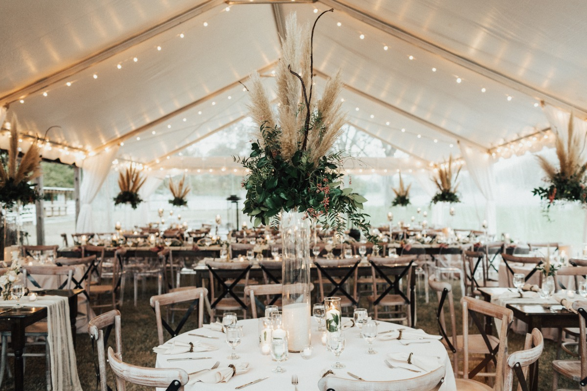neutral wedding reception with pampas grass hanging arrangements