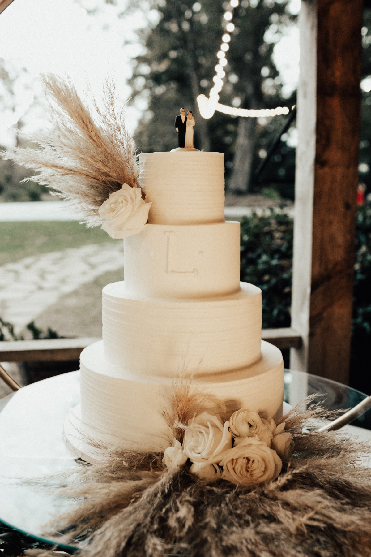 white wedding cake with Pampas Grass
