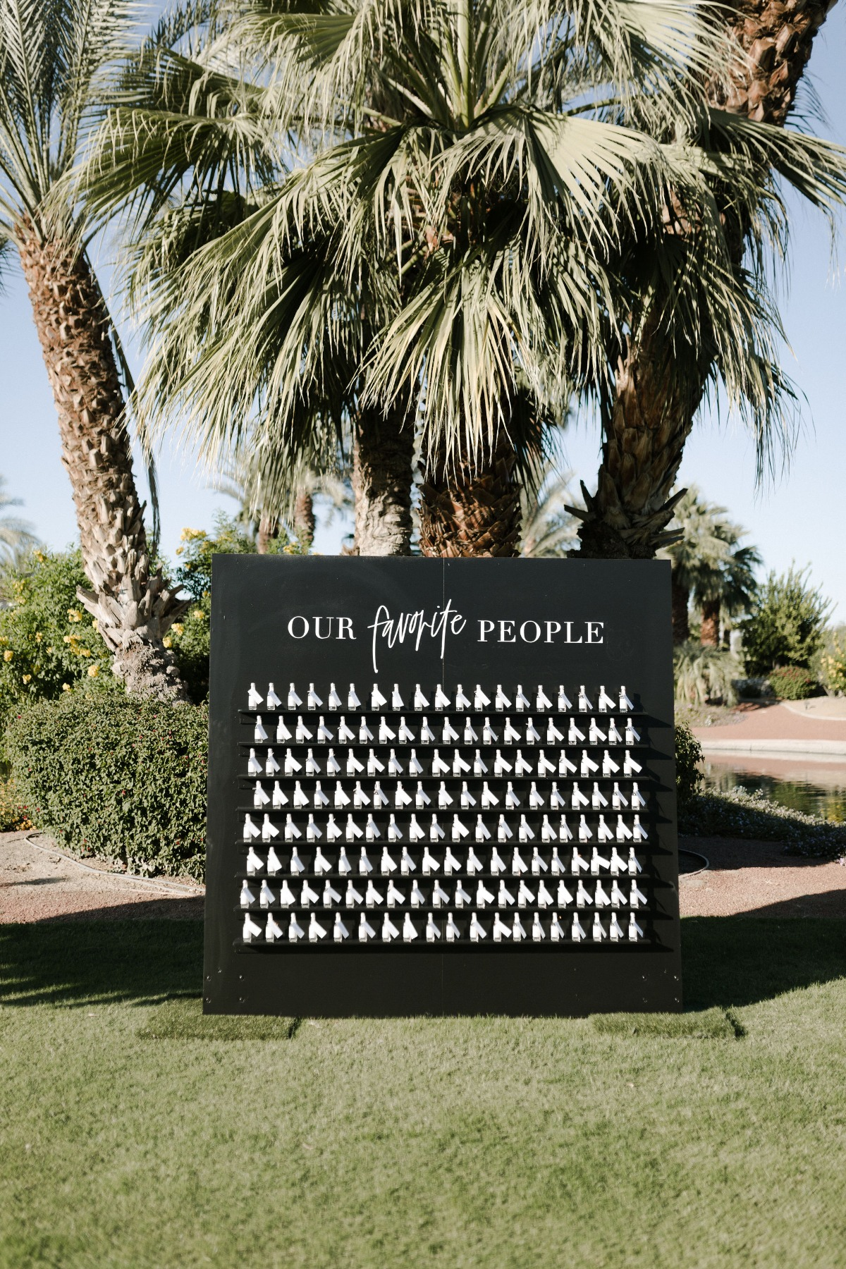 black and white seating chart with tiny bottles of alcohol