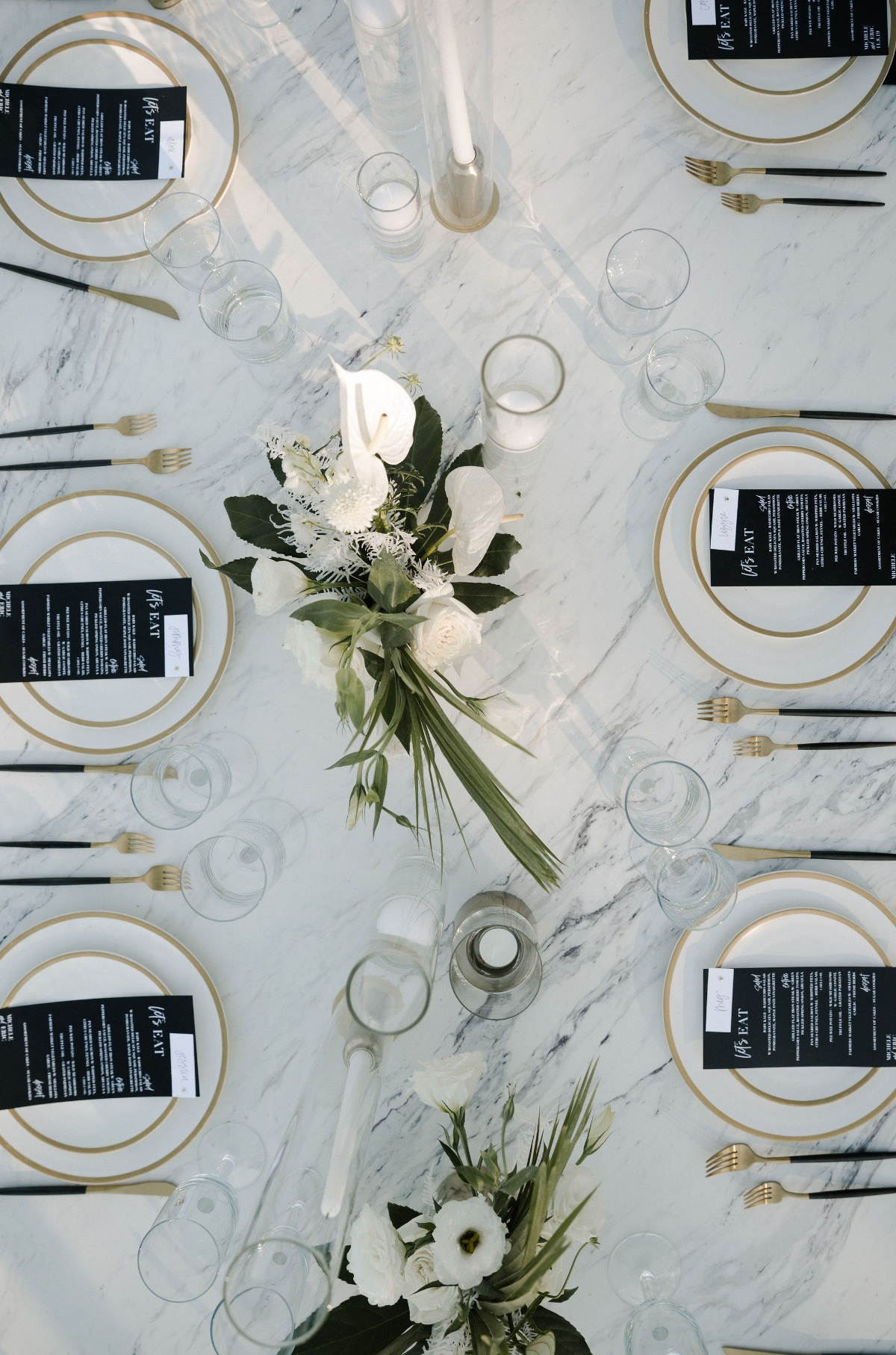 black and white wedding table decor with gold accents