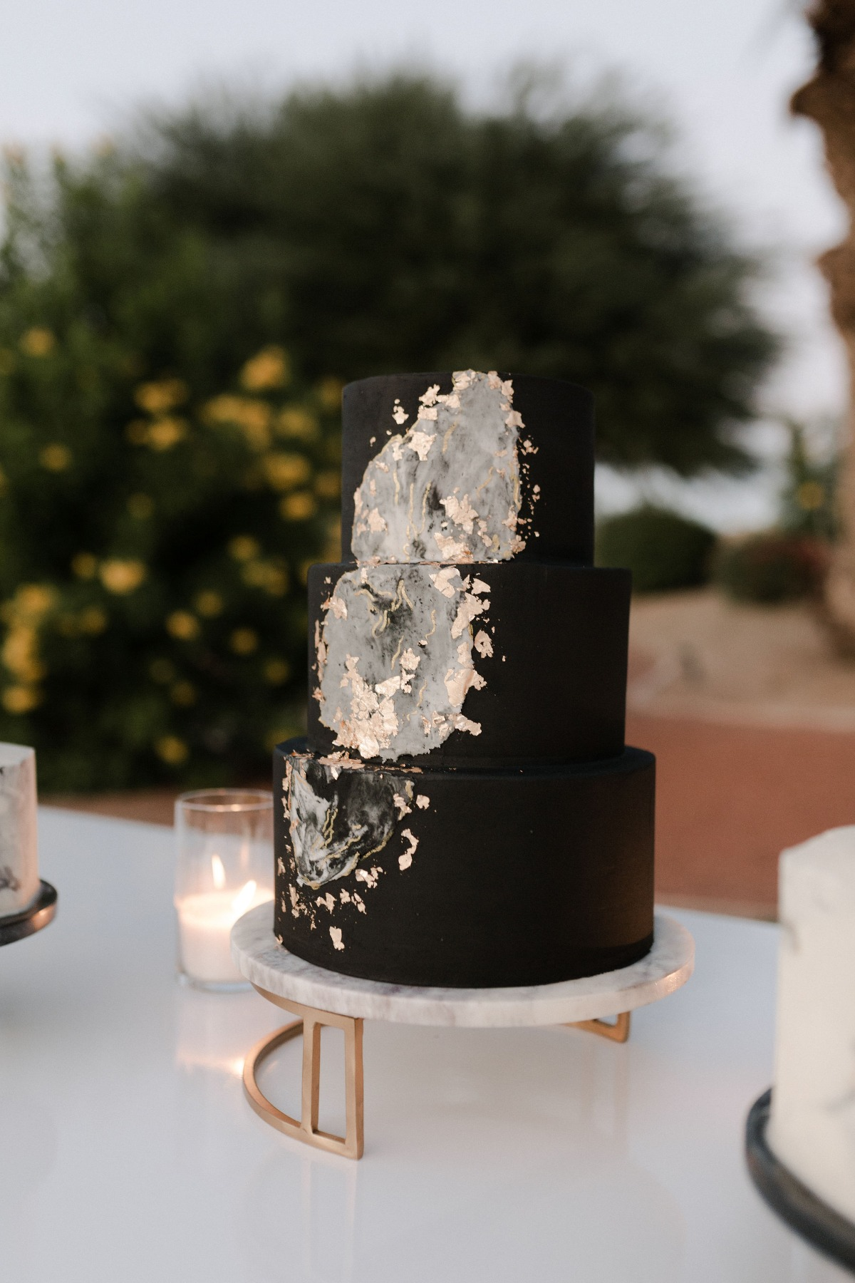 black and white modern cake on marble cake stand