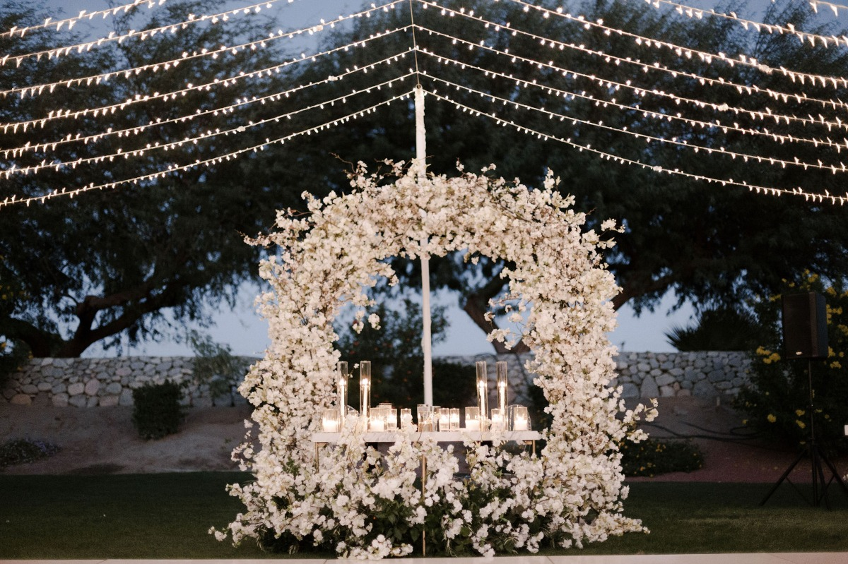 sweetheart table with floral backdrop