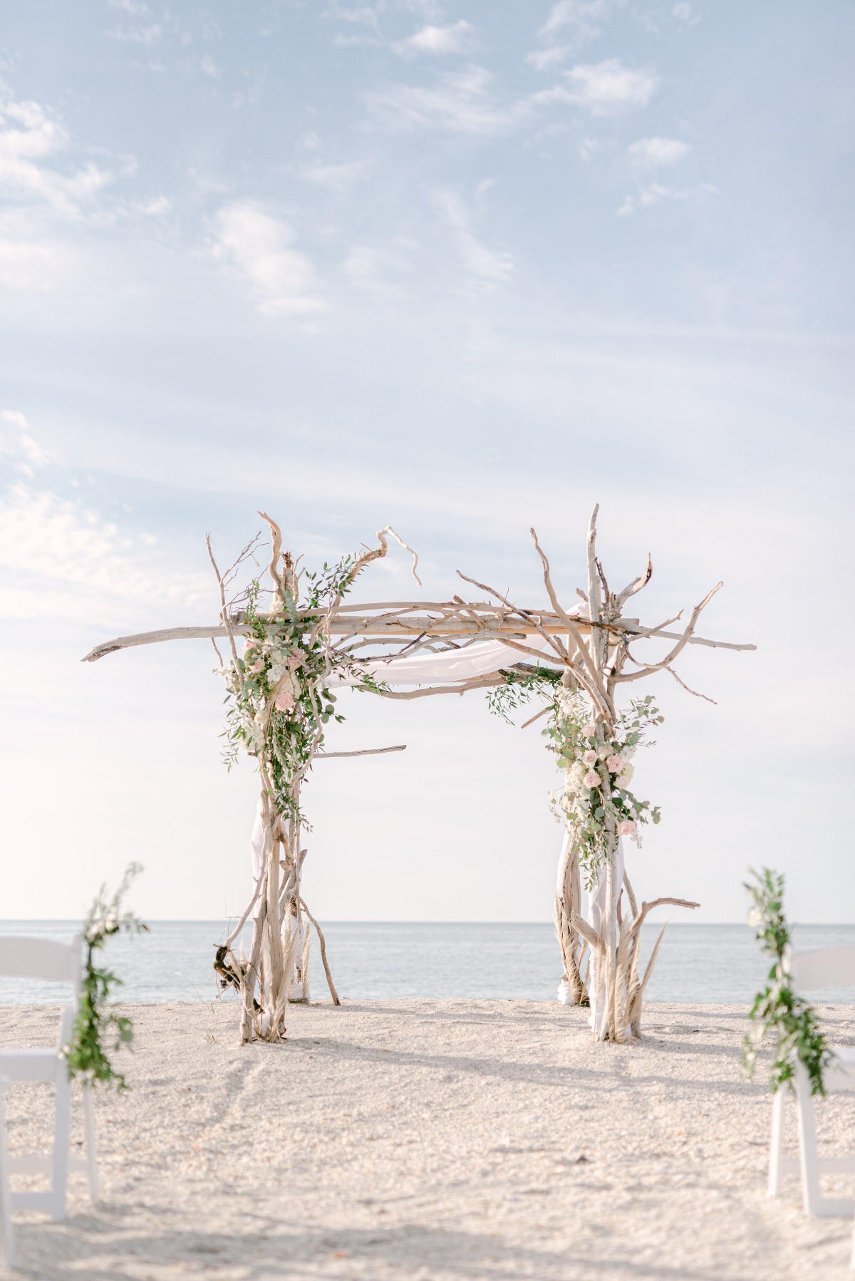 wedding ceremony made of birch wood adorned with flowers