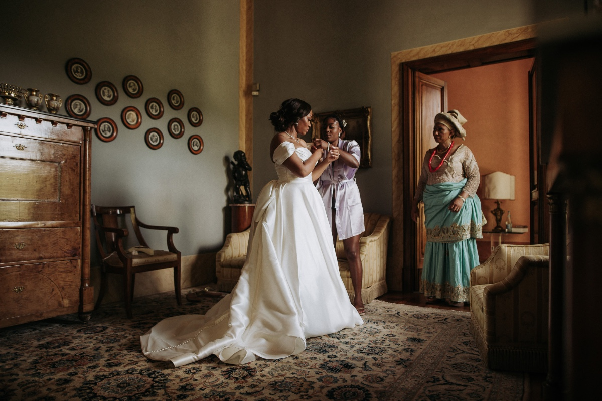 Mom seeing bride for the first time in her wedding dress