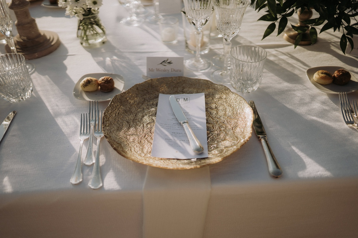 gold wedding plate paired with silver cutlery