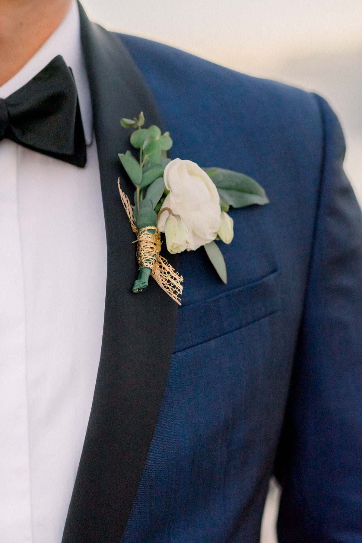 navy blue suit with white flower