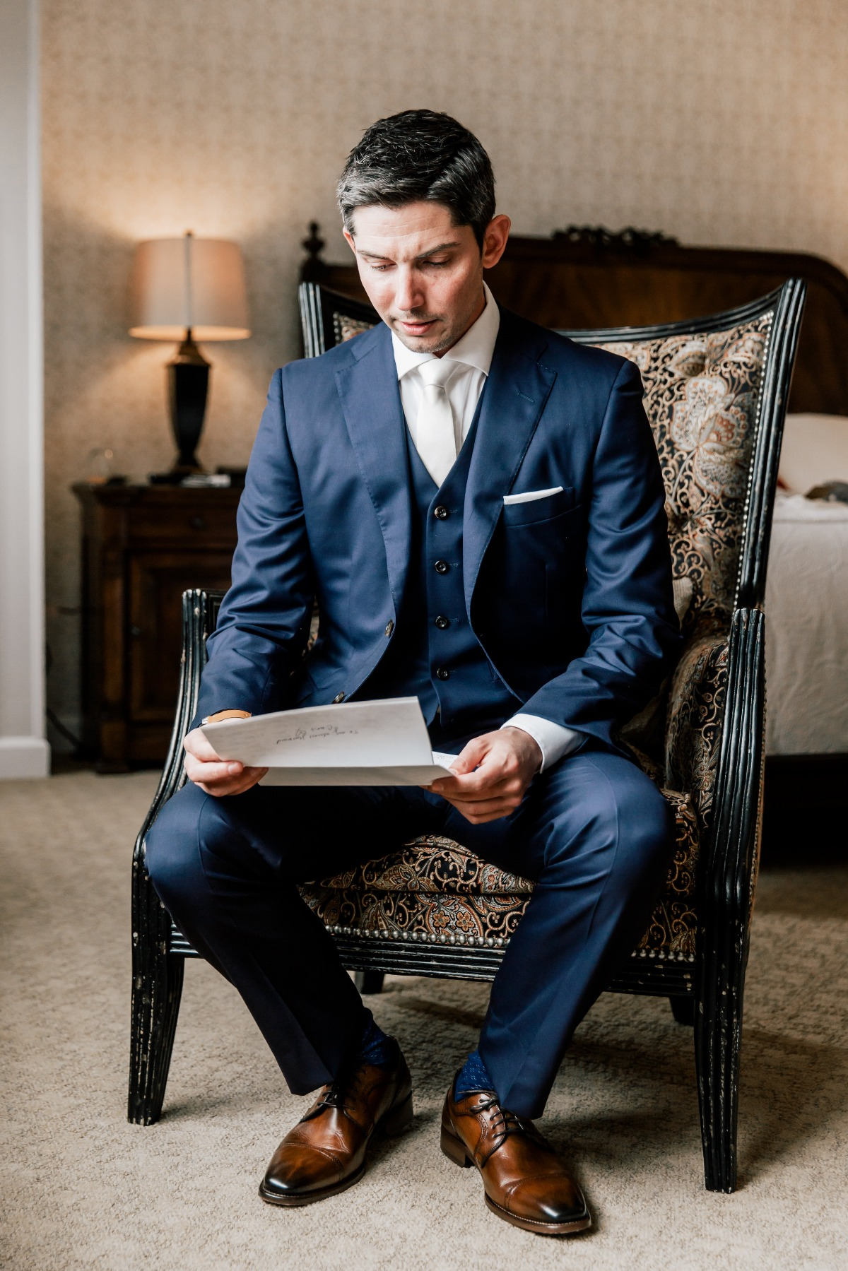 navy blue and white groom suit with white shirt