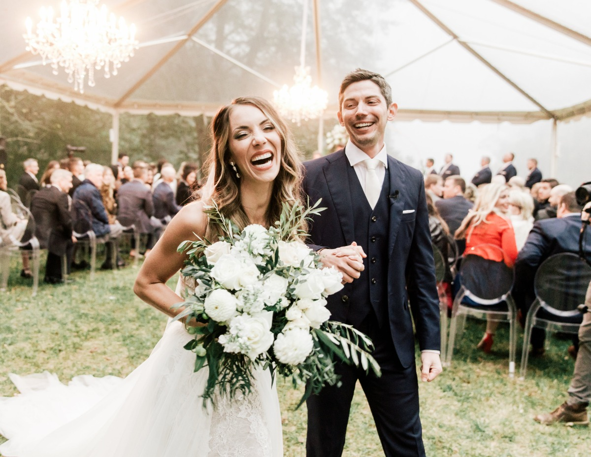 outdoor wedding in the rain under a tent