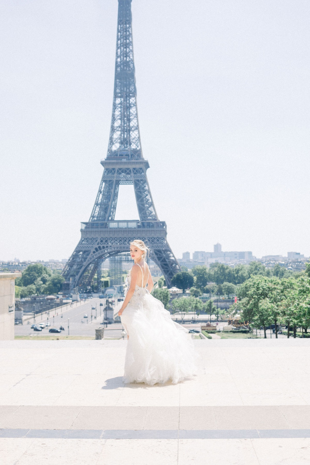 bridal photoshoot by the Eiffel tower in a Myoo Couture wedding gown