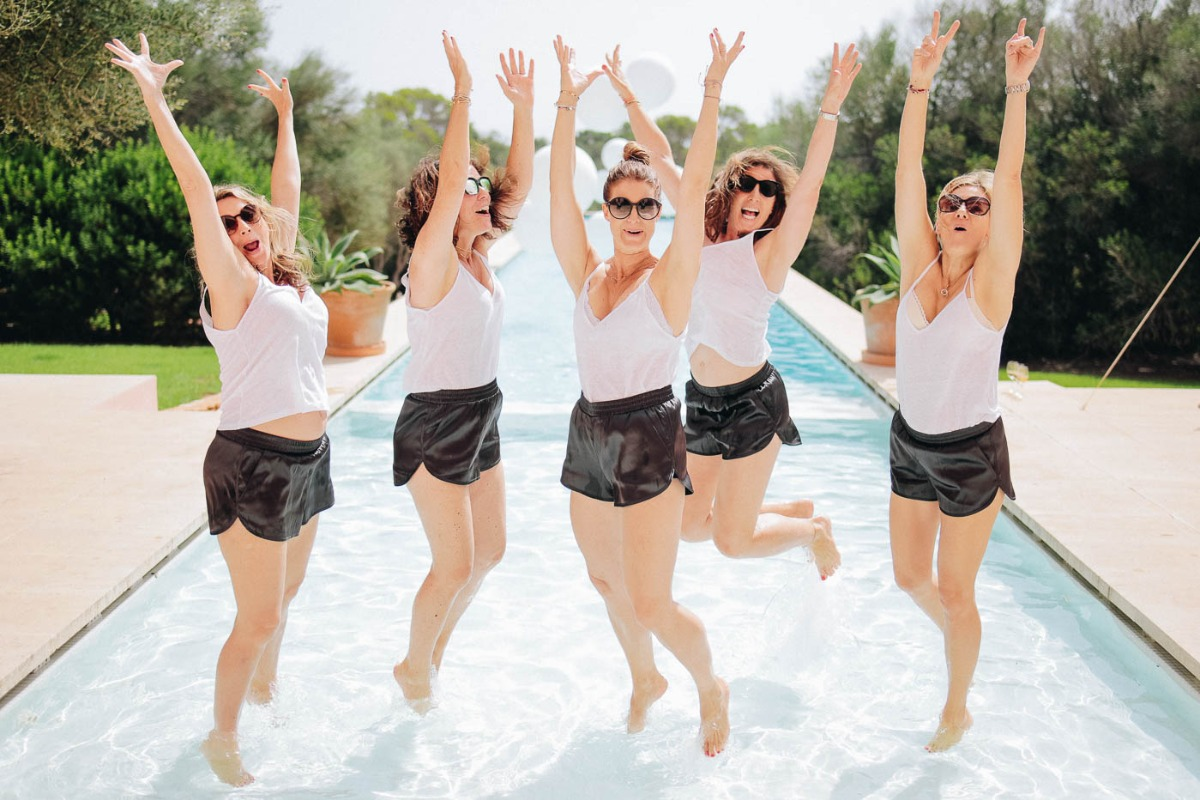bridal party in black shorts and white tank tops