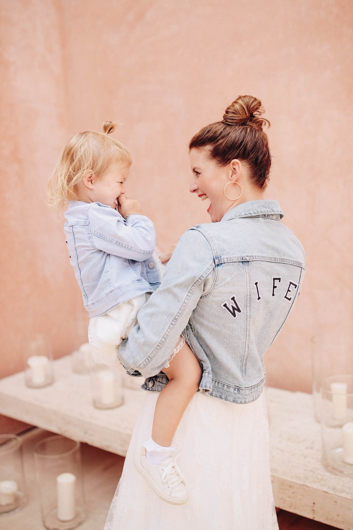 Mom and daughter in matching jean jackets