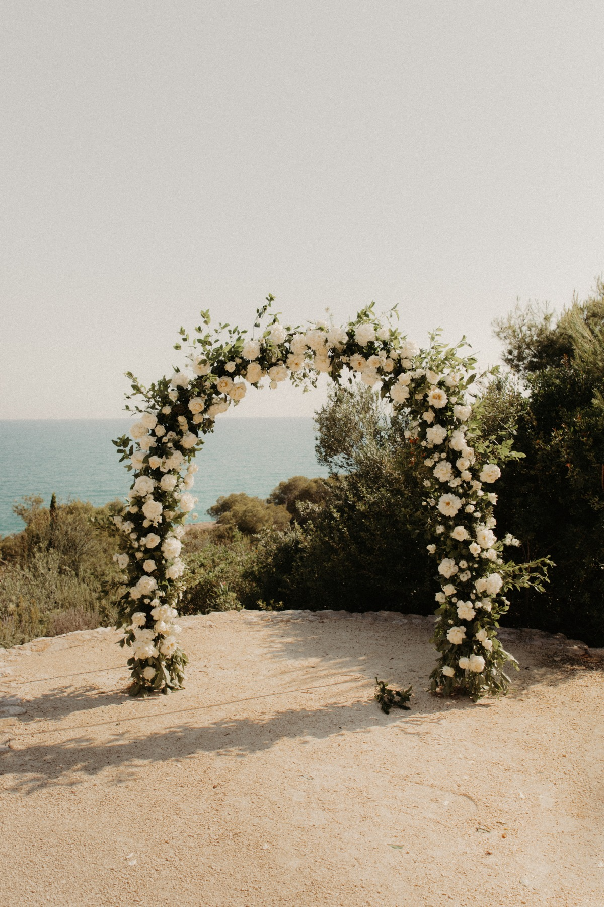 white wedding arch with florals