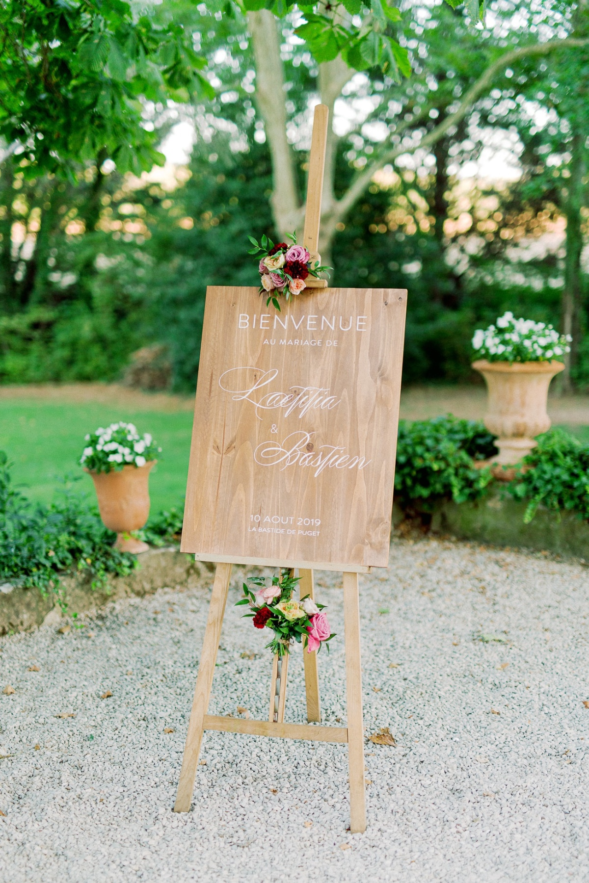 wooden wedding sign adorned with florals