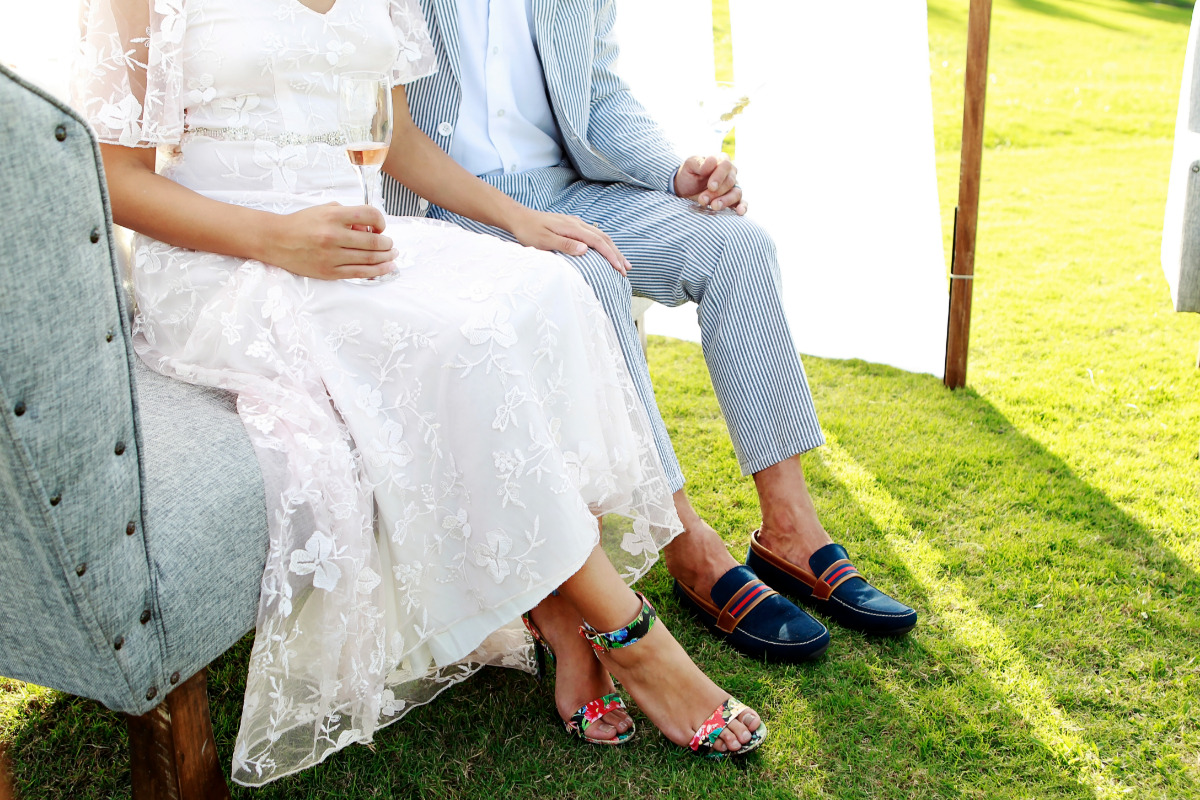 bride and groom in their wedding shoes