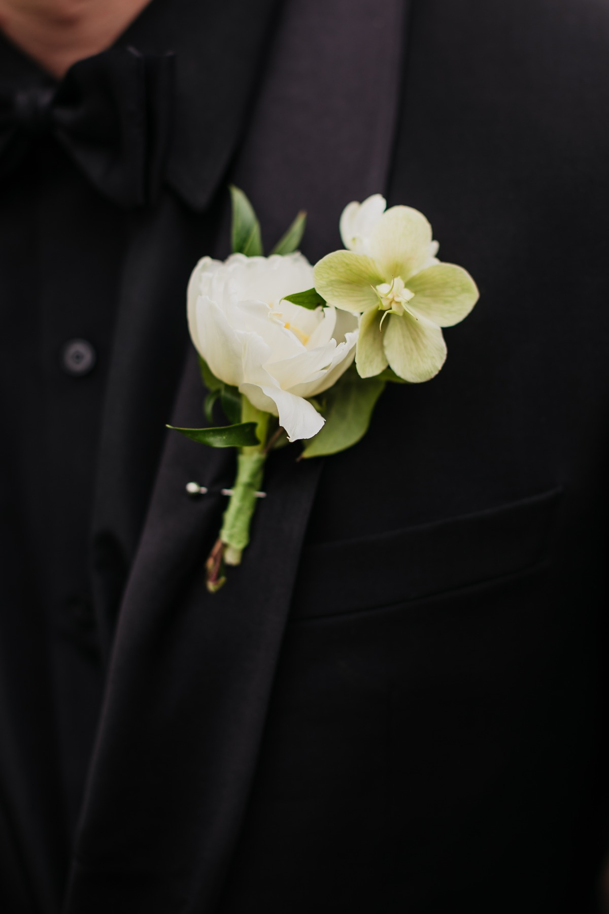 black tuxedo with white boutonnière