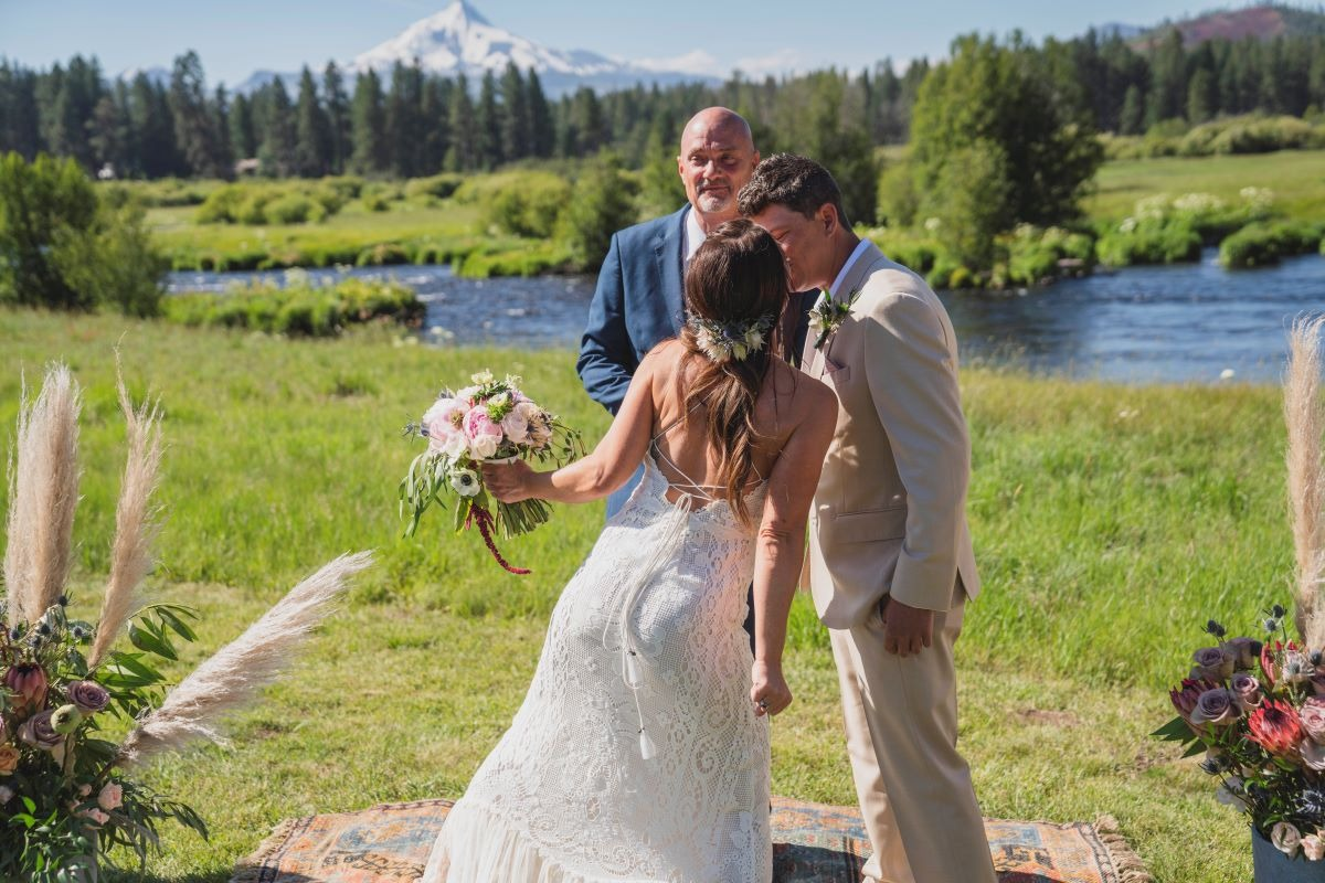 wedding with river in the background