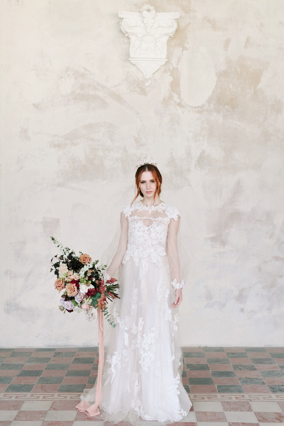 long sleeve wedding dress with full bouquet