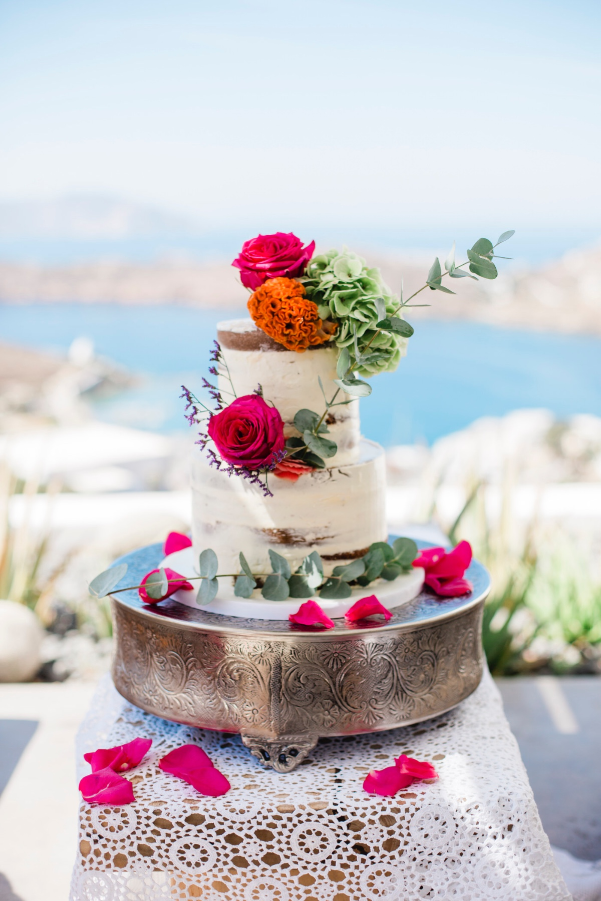 white cake adorned with florals