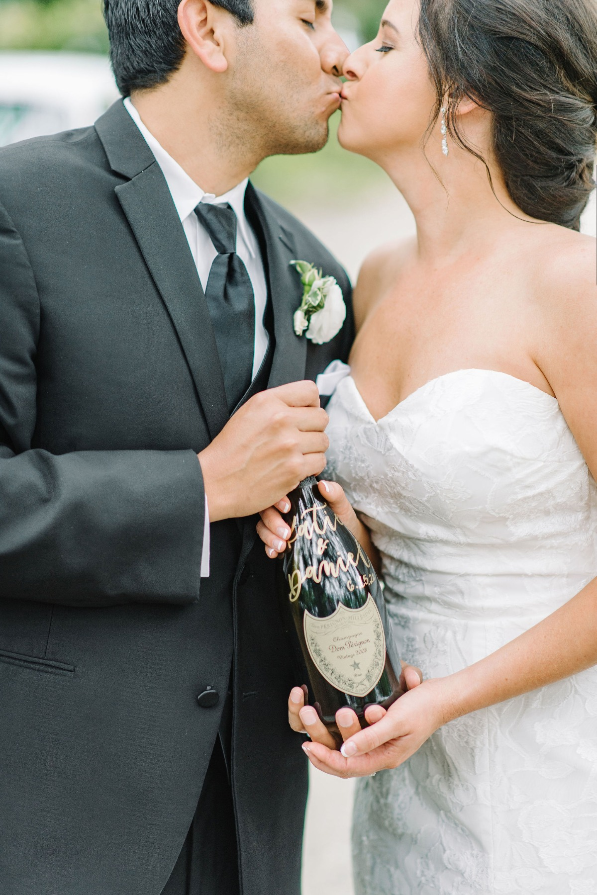 bride and groom with bottle of Champange