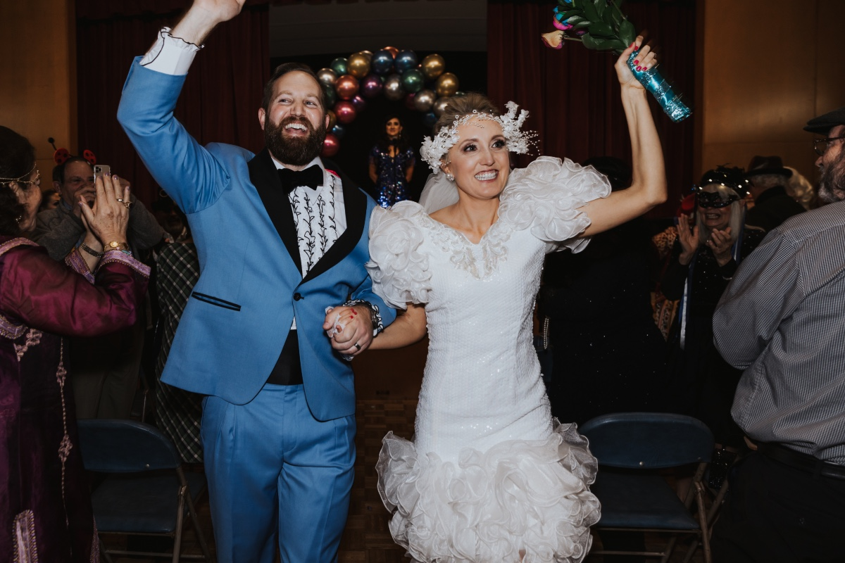 Yay! We're married this 80's inspired costume wedding