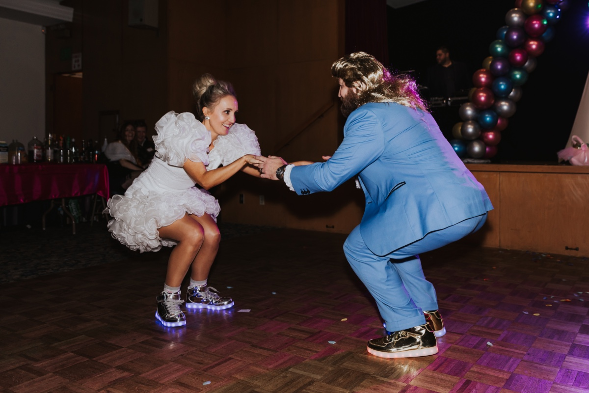 bride and groom in light up sneakers at their costume inspired wedding