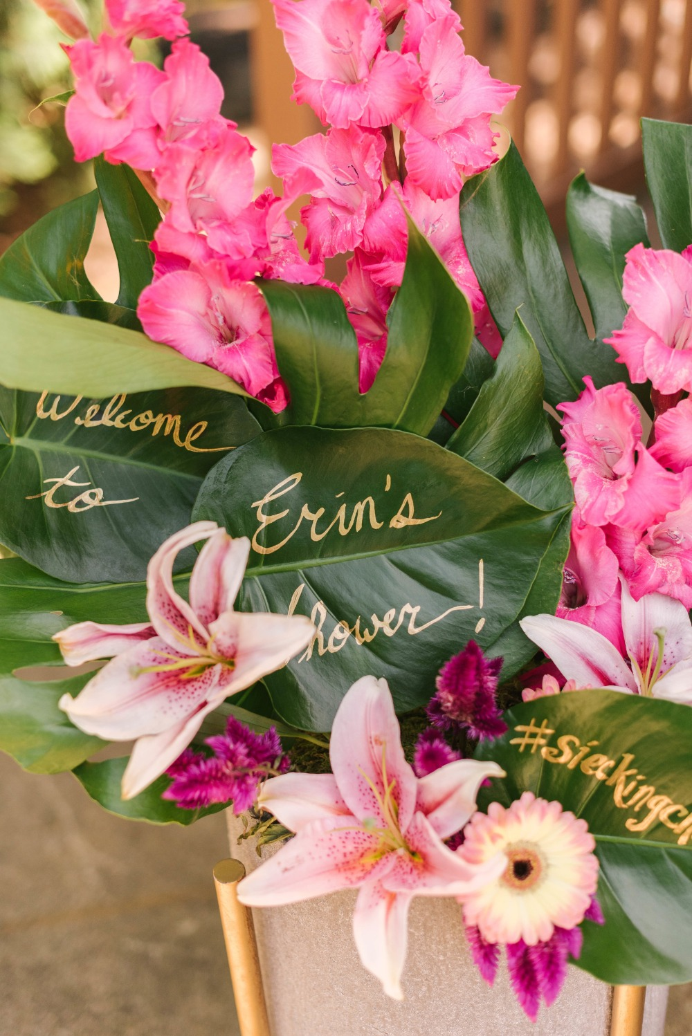 Welcome floral arrangement and tropical bridal shower