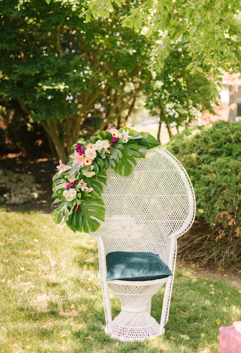 white peacock chair decorated with florals