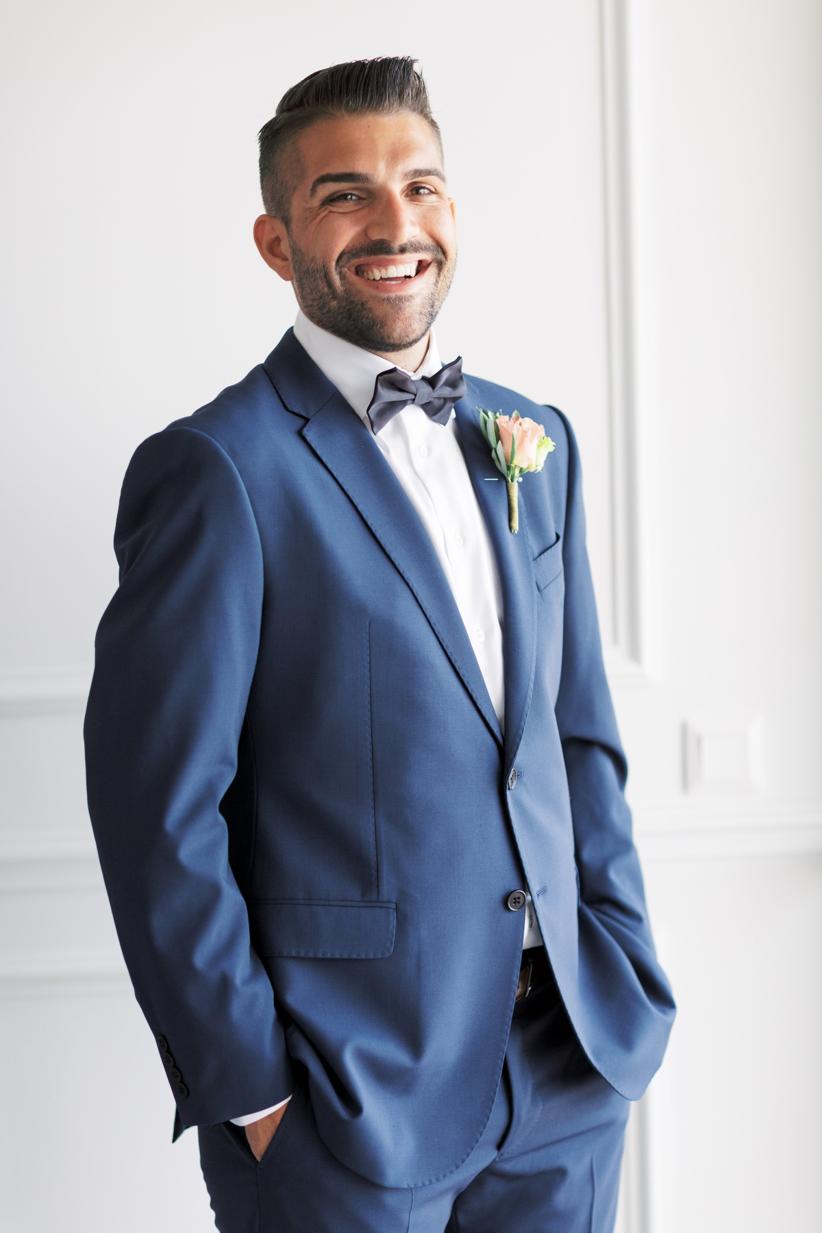 navy suit with black bow tie