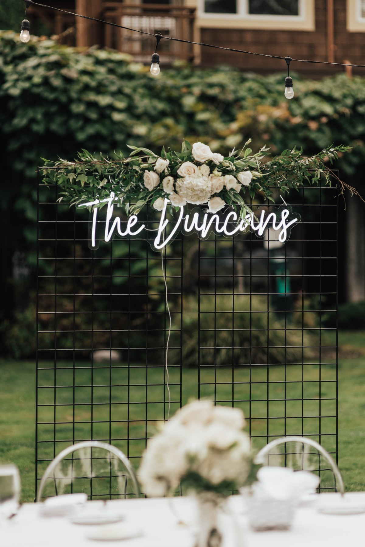 neon wedding sign against a black wireframe