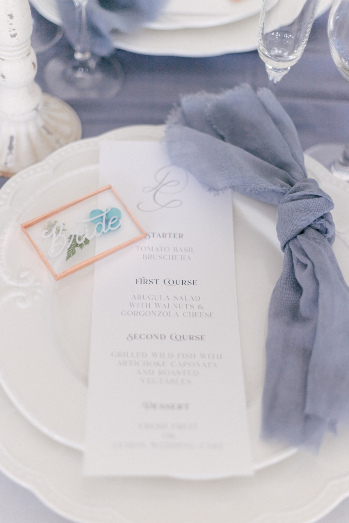 wedding menu with blue napkins
