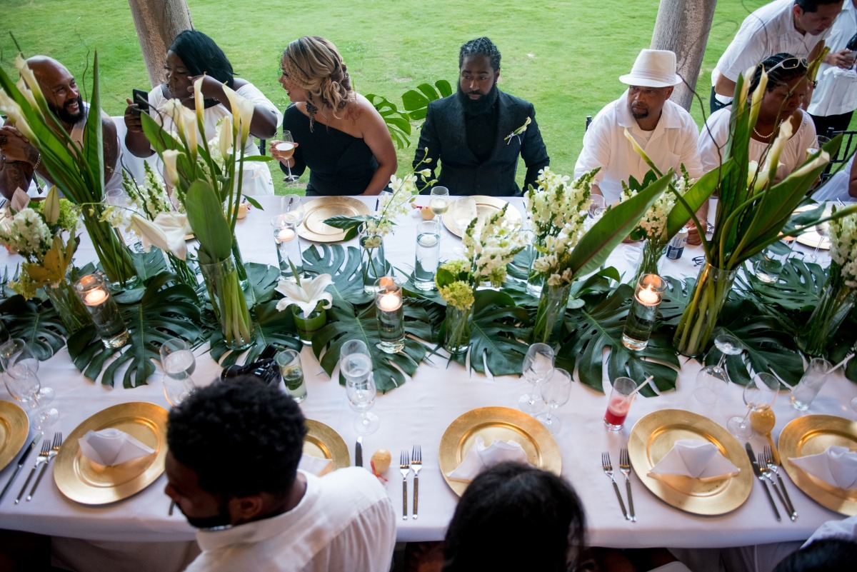 outdoor tropical wedding reception in green and gold
