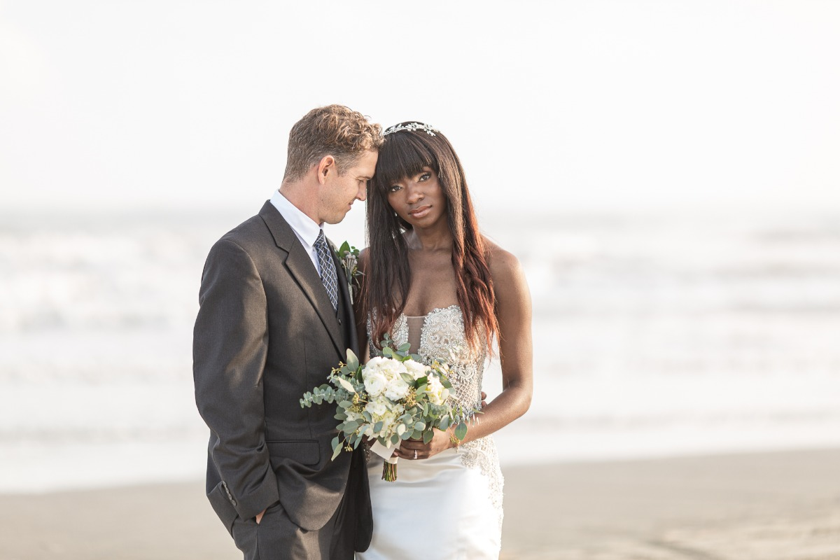 bride and groom pose ideas at the beach