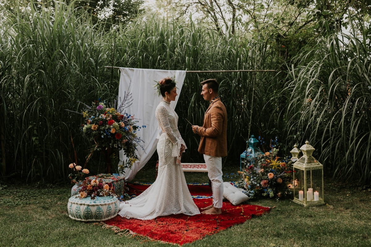 boho chic outdoor wedding on Moroccan rug