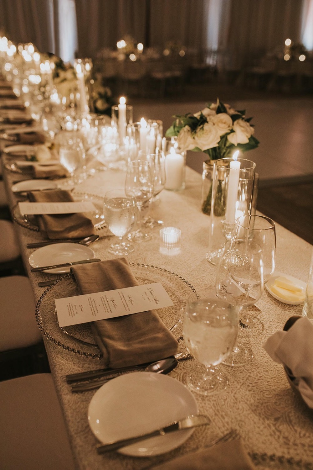 all white and beige candlelit wedding reception