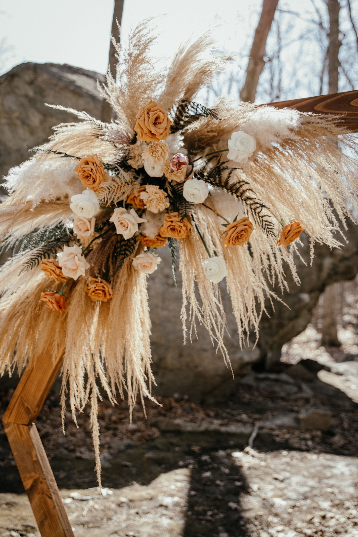 pampas grass and florals on hexagon backdrop