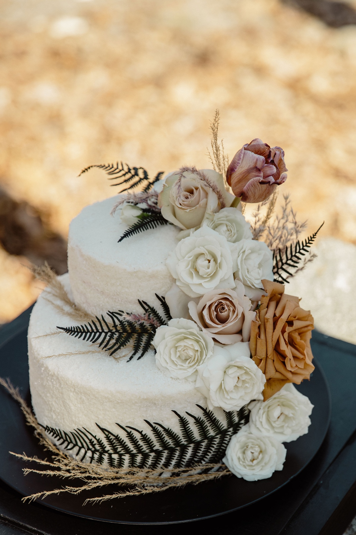 woodsy wedding cake with romantic florals