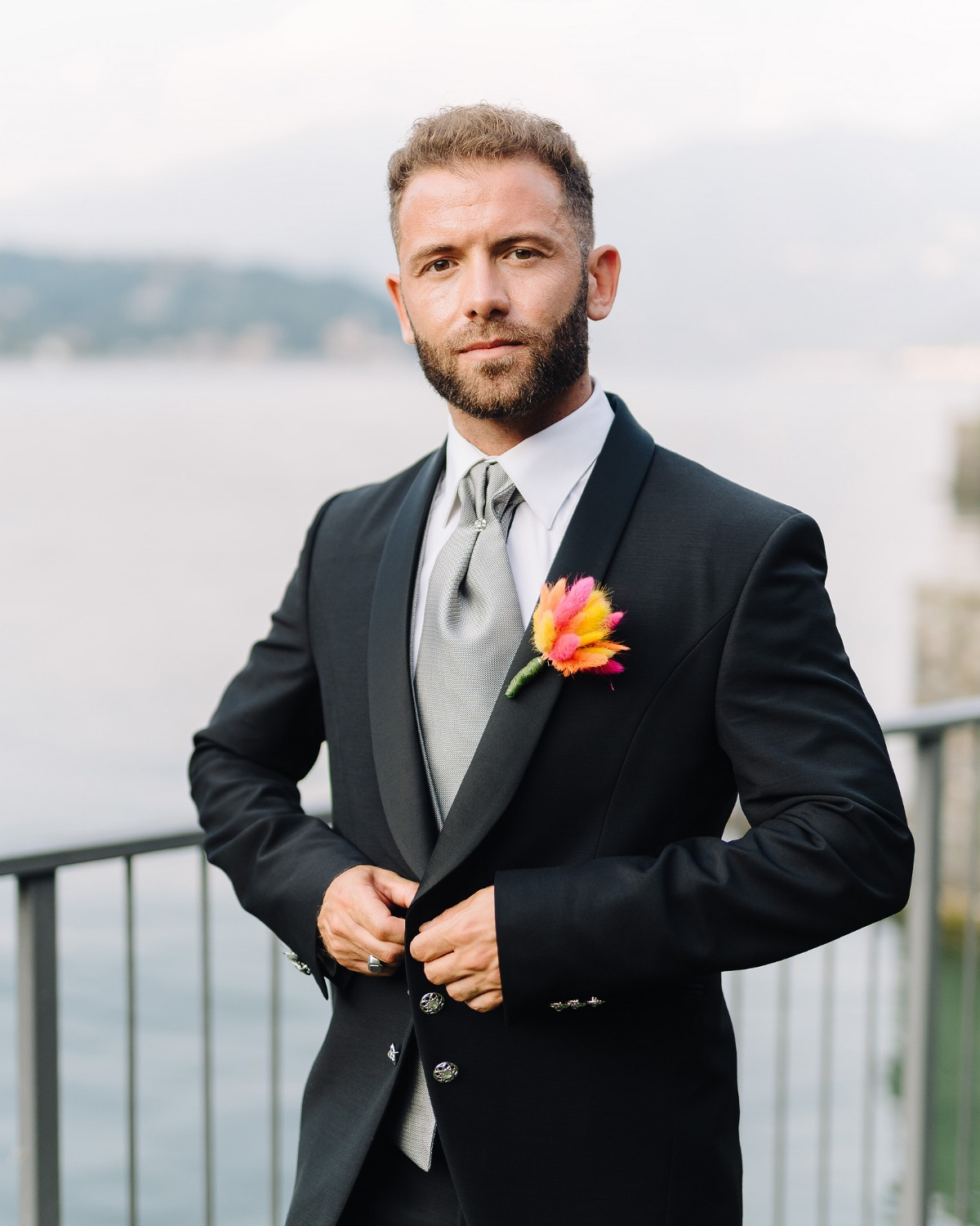 groom with a vibrant boutonniere