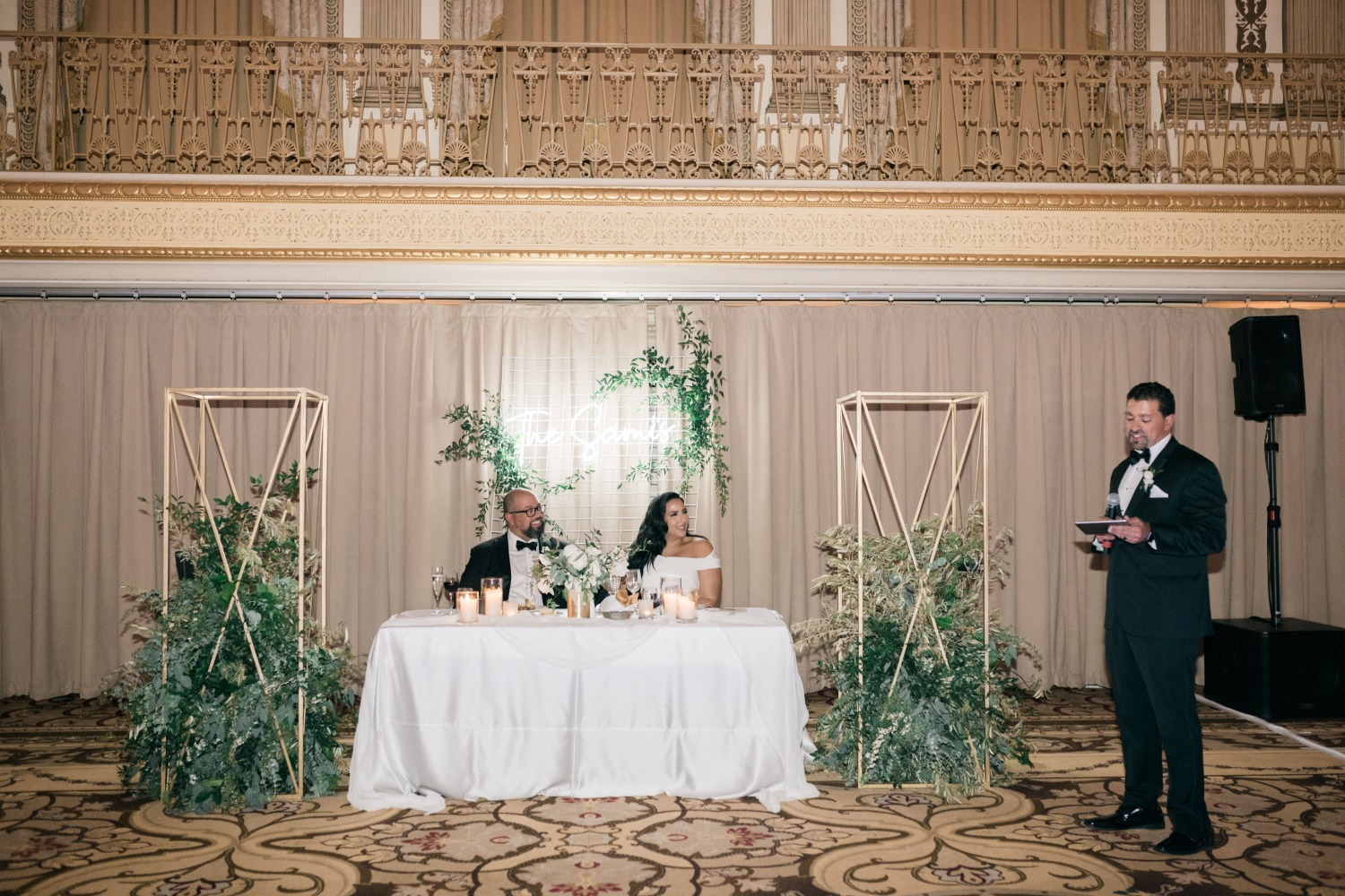 bride and groom at sweetheart table