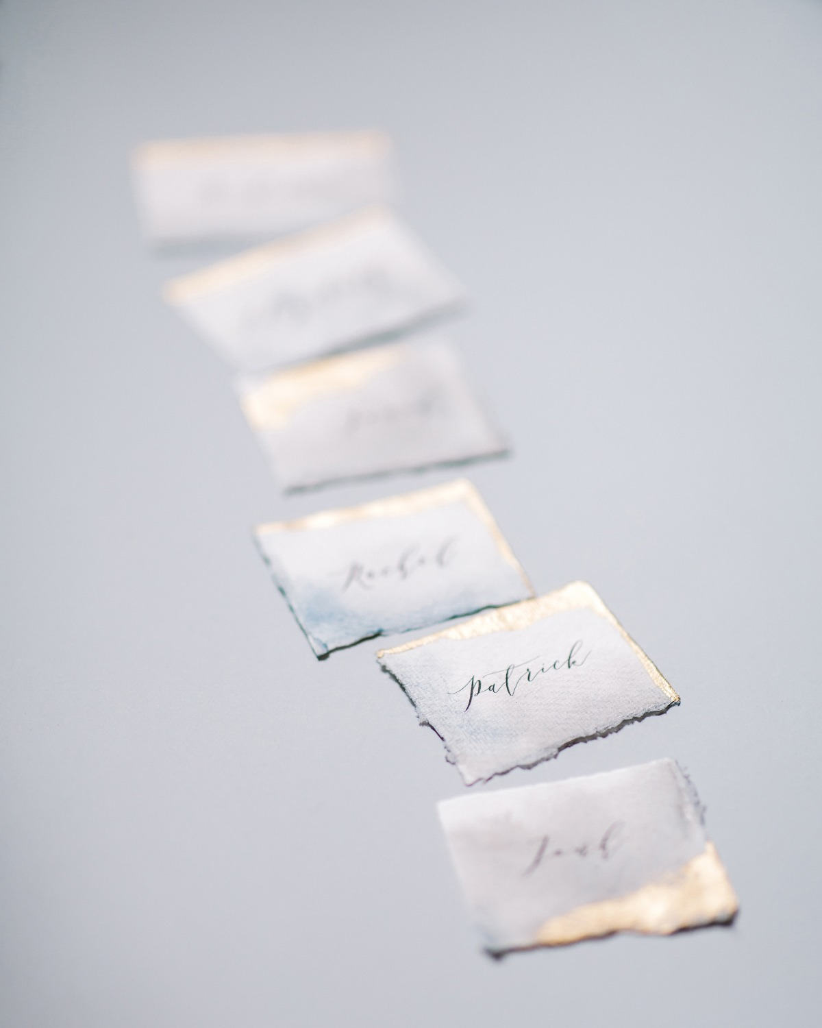 escort cards on handmade paper with gold edges designed by A Pajarita