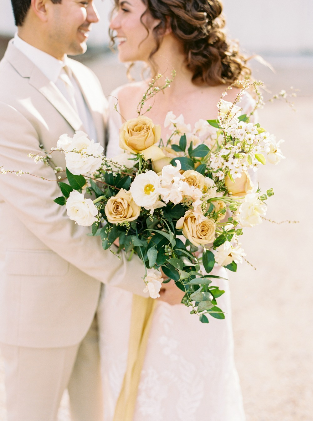 yellow and white wedding bouquet with greenery