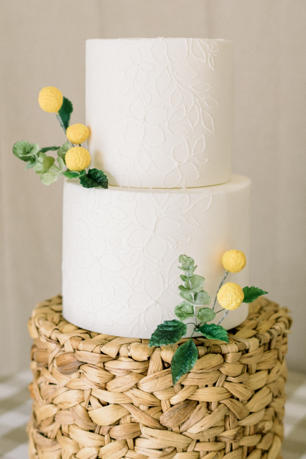 white wedding cake adorned with billy balls from Sweet Autumn Bakery