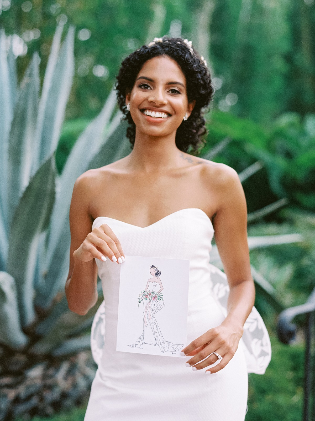 bride had a custom sketch drawn of her in her dress